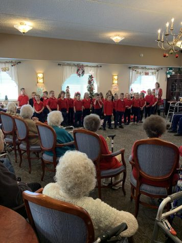 DCC First Grade Shared Christmas Carols with the Residents of Christ the King Manor