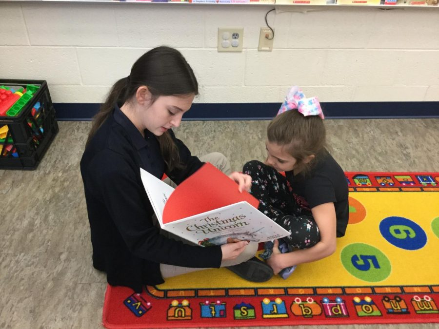 Mrs. Ostermans 8th Grade Class Reads to the Kindergarteners