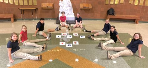 DCC Eighth Grade Creates Superheroes to Learn about Catholic Social Teaching