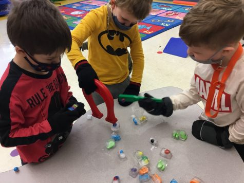 DCC Preschool Students Explore the Letter M with Magnets and Mittens