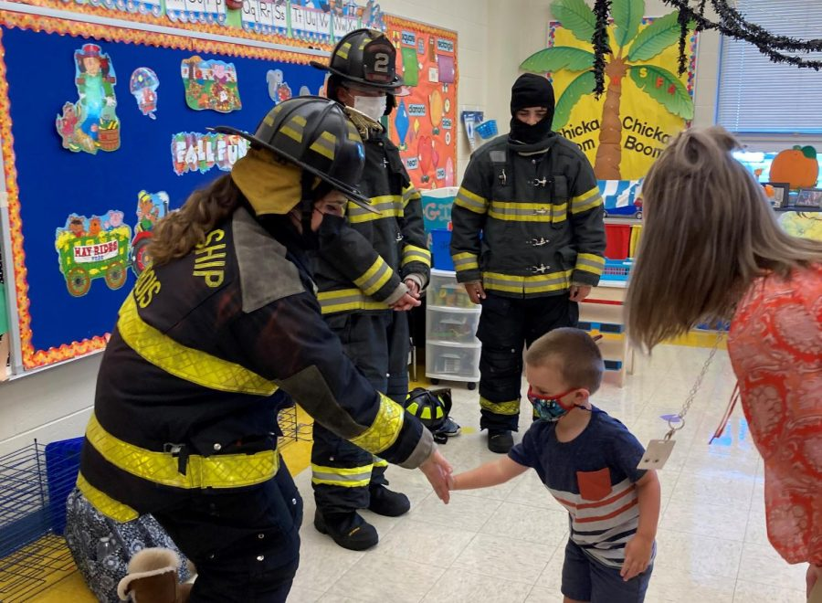 DCC Students Who are Volunteer Firefighters Teach Preschool about Fire Safety